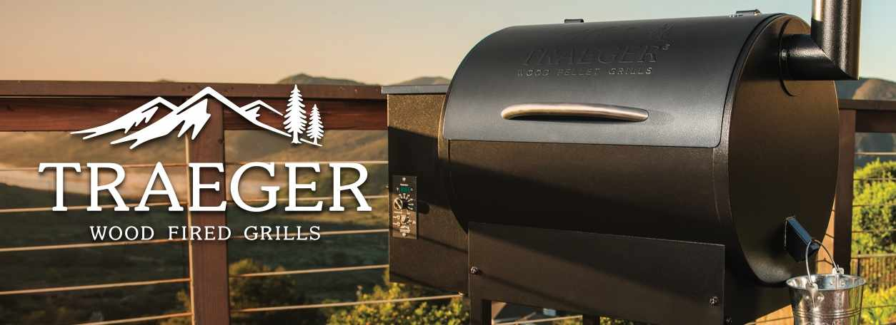Traeger logo and Traeger grill with mountainous background